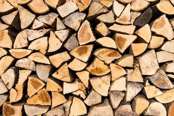Photo sur Aluminium Texture de bois de chauffage Stacked and dried firewood for the winter season