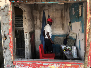 A man wearing a hat from the ruling Frelimo party, is seen in Beira