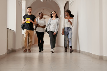Group of four multiracial students spending time together