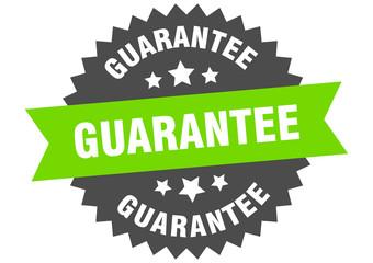 guarantee sign. guarantee green-black circular band label