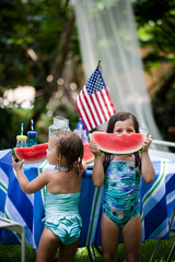 Kids Eating watermelon in their yard on the fourth of July