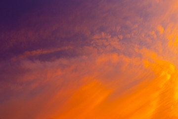 Beautiful red clouds in the sky at sunset. Nature background.