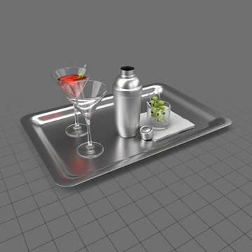 Cocktail with shaker on tray