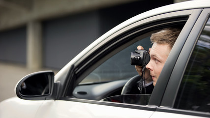 Reporter secretly taking photo sitting in auto, spying paparazzi, exclusive