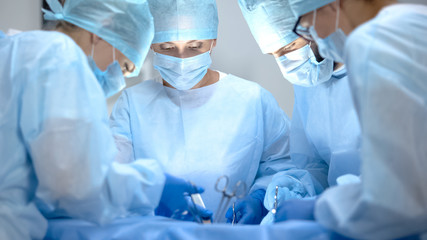Surgical operating team performing thoracic surgery in modern hospital, health