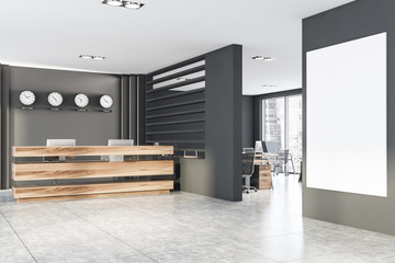 Grey office with clocks, reception and poster