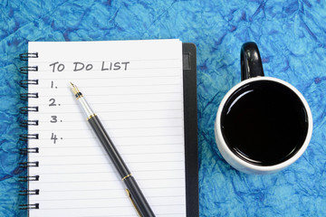 To Do List written on a book with pen and coffee cup