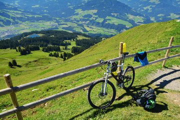 Hohe Salve mountain view and a bike near a wooden fence, Austrian alps