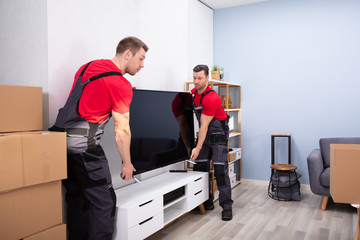 Professional Male Movers Doing Home Relocation