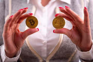 Bitcoin coins in woman's hands
