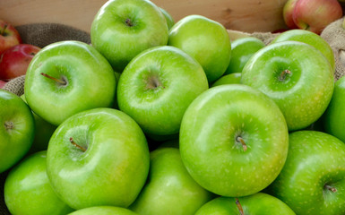 Granny Smith apples grown in the Hudson Valley of New York State for sale at a local farm stand. Closeup.