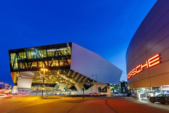 Porsche Museum Stuttgart at night Germany logo modern architecture copyspace