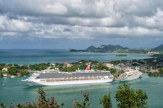 Castries, Saint Lucia - November 11, 2015: large cruise ship or liner Carnival Liberty. tourist boat in bay or harbor. picturesque landscape. luxury trip. summer travel and vacation. water transport