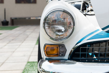 Closeup of vintage car headlights