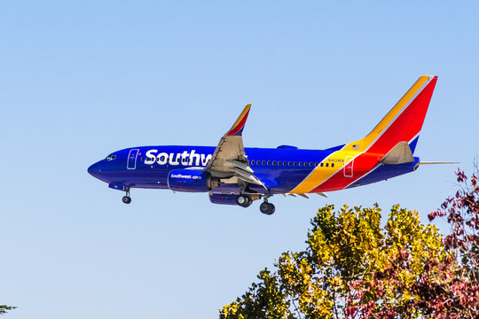 Oct 9, 2019 San Jose / CA / USA - Southwest Airlines aircraft approaching Norman Y. Mineta San Jose International Airport and preparing for landing; blue sky background