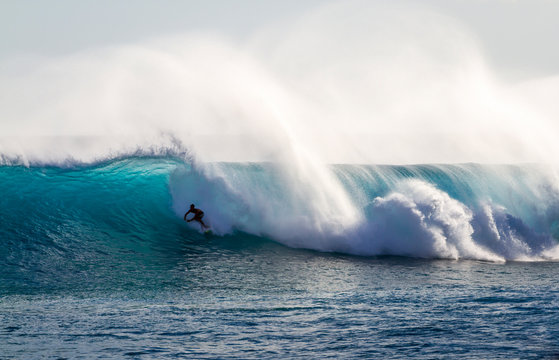 Surfing a wave in Hawaii