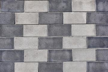 Light and dark grey brick wall background