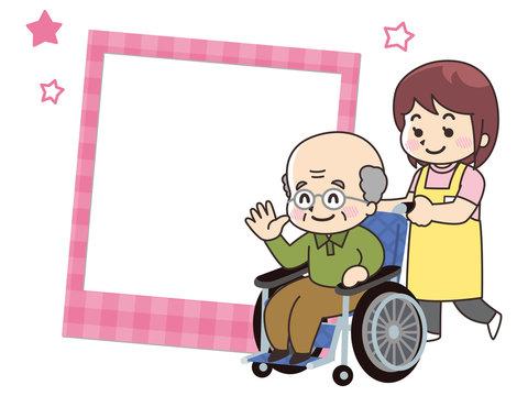 介護士の女性と車椅子のおじいさん 写真フレーム