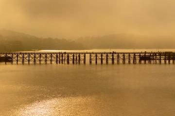 foggy of sangkhalburi wooden bridge one of most popular traveling destination in kanchanaburi western of thailand