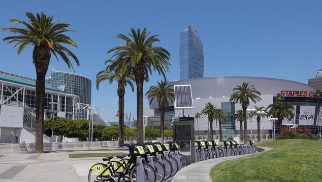 Wide shot of Los Angeles Convention Center with a row of parked Metro Bikes. Staples Center is visible on the right. Photo taken in Los Angeles, CA / USA on April 28, 2019.