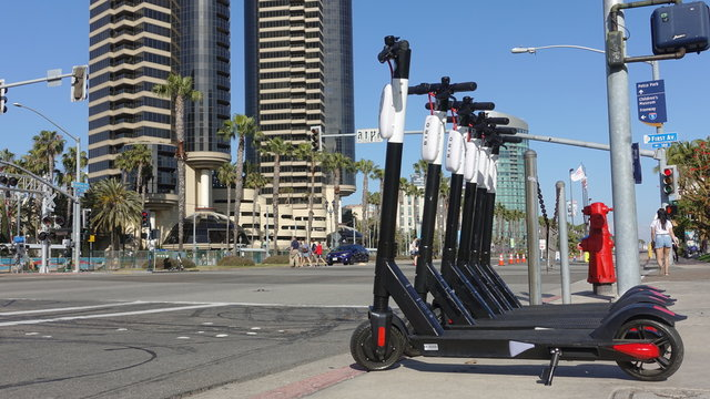 A row of BIRD electric scooters parked and ready for rent in downtown San Diego. Taken in San Diego, CA / USA - May 31, 2019.