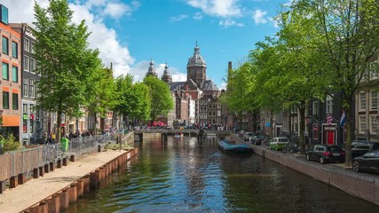 Wall Mural - Saint Nicholas Church with Canal and Dutch buildings in Amsterdam city, Netherlands