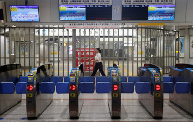 A view of closed ticket gantries for the Shinkansen bullet train service, which is suspended temporarily due to Typhoon Hagibis, at Tokyo Station in Tokyo
