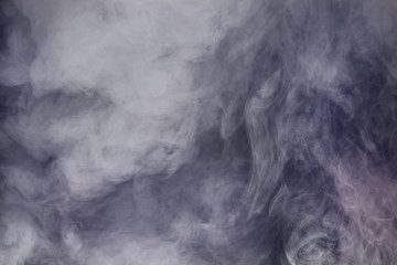 Smoke and fog in front of black background as a texture
