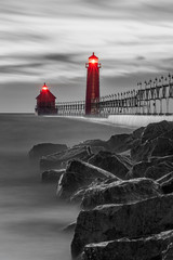 selective color red lighthouses with rocks