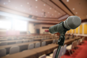 Microphone over the blurred forum Meeting Conference Training Learning Coaching room Concept, Blurred background.