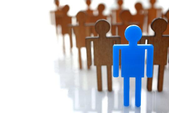 Male blue plastic toy businessman silhouette wooden crowd figure background closeup. Manipulate work recruitment transfer labour inspectorate experience exchange man worker subordination human concept