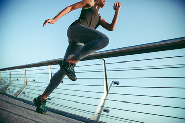 Putting knee up while exercising outdoors stock photo