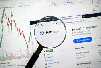 Aelf altcoin site under magnifying glass.