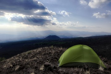 Dramatic Sky, Tent And Volcanic Landscape In Etna Park, Sicily