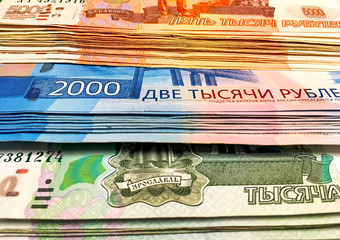 Money rubles pack on a green isolated background. Russian banknotes one thousand, five thousand, two thousand