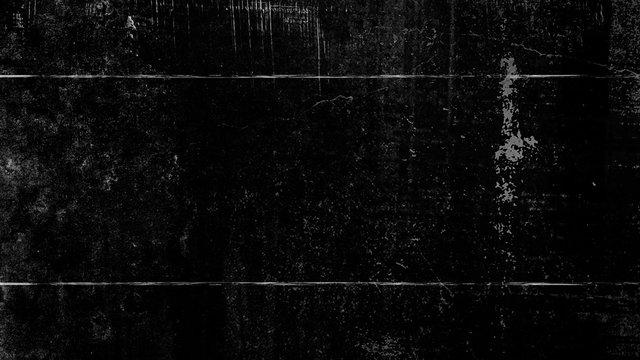 Black vintage grunge scratched background, distressed old texture. Design element.