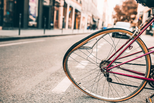 Damaged bicycle with a bent wheel during a road accident collision