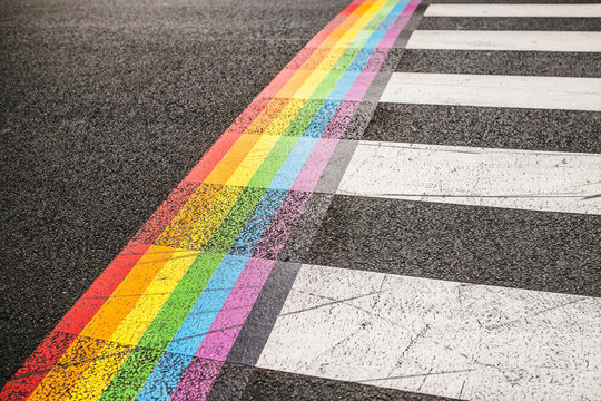 Rainbow markings on the pavement at a pedestrian crossing - rights of the LGBT community - gay sexual minority community