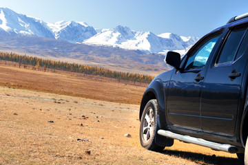 Travel concept with big 4x4 car in mountains. Car for traveling in countryside.