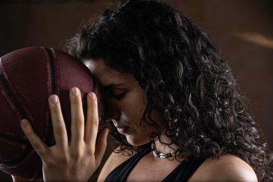 Young sportswoman holding basketball ball