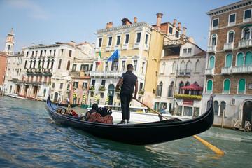 Foto op Aluminium Gondolas Venice / Italy - September 29th 2019: Gondolier rowing a gondola in Grand Canal