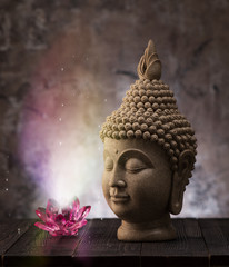 Buddha head statue and lotus flower decoration. Buddhism and meditation concept