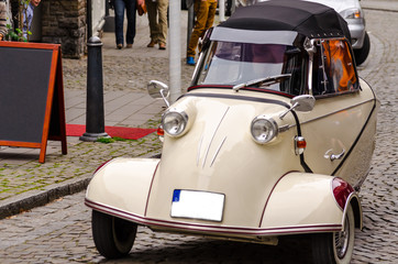 Essen Kettwig, Nrw, Germany - March 30, 2014: Essen Kettwig downtown, Messerschmitt cabin scooter on a city transit at a oldtimer rally.  Produced by the Messerschmitt company.  Designer of the vehicl