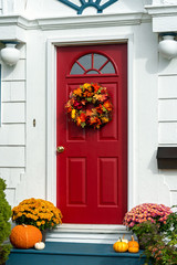 Front of a home decorated for fall.