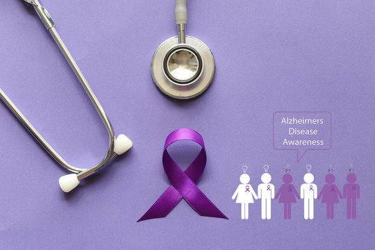 Stethoscope and person with purple ribbon on purple background, Symbol of Alzheimers awareness, Healthcare and medicine concept.