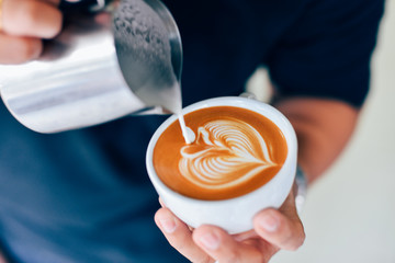 Fototapeta Coffee latte art in cafe obraz