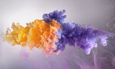 mix of orange and purple water color paint splash background