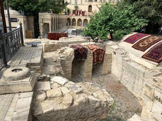 Baku, Azerbaijan. Inner city of Icheri Sheher, Asaf Zeynalli street. Fragment of ancient masonry at the walls of the Maiden tower