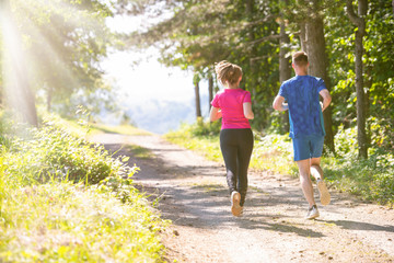 Keuken foto achterwand Jogging young couple jogging on sunny day at nature