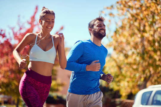 Young man and woman jogging at the park. healthy lifestyle.